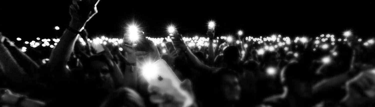 crowd holding phone